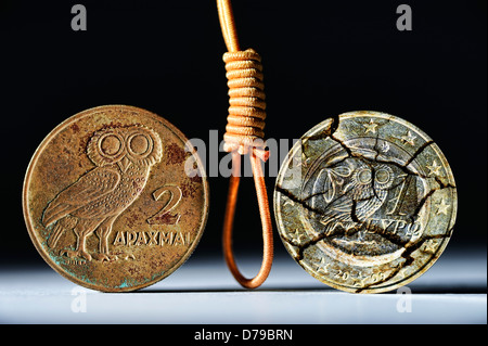 Greek drachm and Greek euro-coin one with gallows, return of Greece to the drachm , Griechische Drachme und griechische - Stock Photo