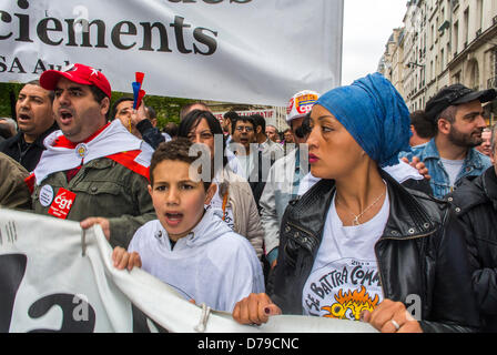 Paris, France. French Labor Unions, CGT, Demonstration on May 1, Labor Day, Migrant Families, Peugeot, Carrying - Stock Photo