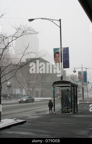 Looking towards Lake Michigan from East Chicago Avenue Chicago Illinois during a snowstorm in December. - Stock Photo