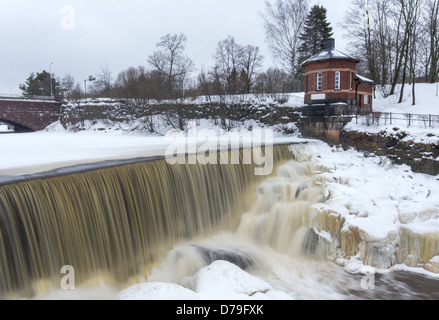 Waterfall at the Power Plant Museum buildings located in Old Helsinki on the Western fork of the Vantaa River, Helsinki, - Stock Photo
