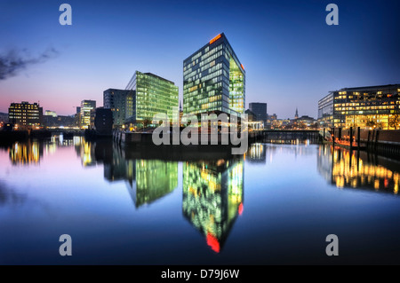 Reflecting publishing house and Ericus office in the Ericusspitze in the harbour city of Hamburg, Germany, Europe - Stock Photo