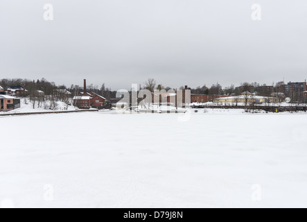 The frozen snow covered Vantaa River in 'Old Town' part of Helsinki with the Museum of Technology on the distant - Stock Photo