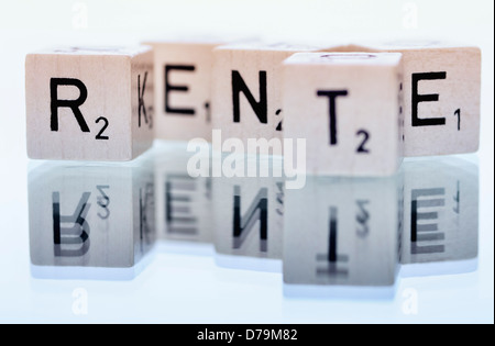 Cube letters with the word Pension , Würfelbuchstaben mit dem Wort Rente - Stock Photo