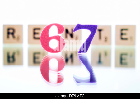 Cube letters with the word Pension, Pension beginning at the age of 67 years , Würfelbuchstaben mit dem Wort Rente, - Stock Photo