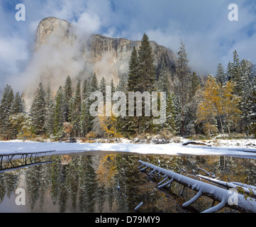 Yosemite National Park, California El Capitan reflected in still pool with fresh snow at Cathedral Beach, Yosemite - Stock Photo