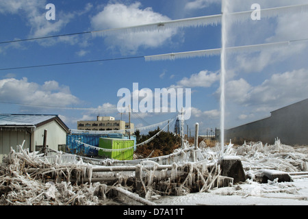 Damaged Pipe Sprays Water After Tsunami Earthquake in Japan - Stock Photo