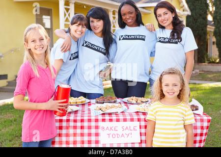 Women And Children Running Charity Bake Sale - Stock Photo