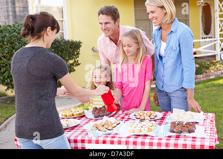 Family Running Charity Bake Sale - Stock Photo