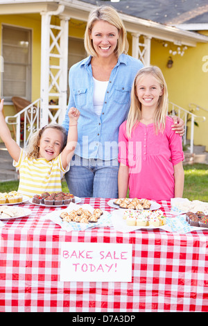 Mother And Children Running Charity Bake Sale - Stock Photo