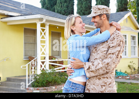 Wife Welcoming Husband Home On Army Leave - Stock Photo
