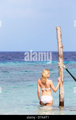 Woman In Bikini Standing In Beautiful Tropical Sea - Stock Photo