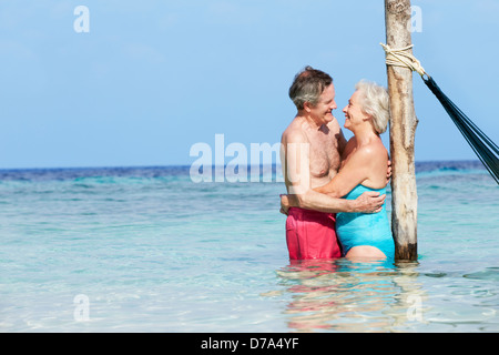 Senior Romantic Couple Standing In Beautiful Tropical Sea - Stock Photo