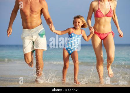 Family Having Fun In Sea On Beach Holiday - Stock Photo
