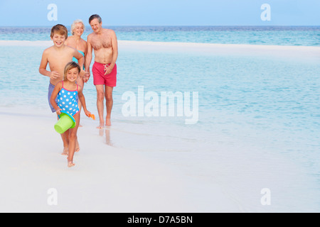 Grandparents And Grandchildren Having Fun On Beach Holiday - Stock Photo