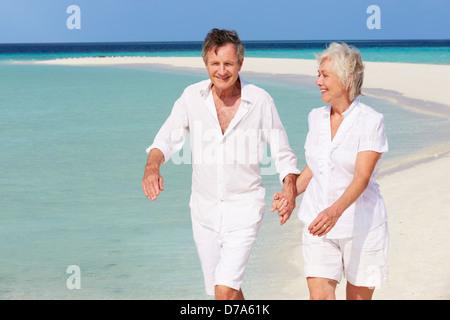 Senior Romantic Couple Walking On Beautiful Tropical Beach - Stock Photo