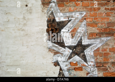 Brick wall with graffiti - couple of stars on the wall - Stock Photo