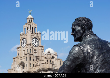 Bronze statue of Captain F.J.Walker situated at  Pier Head, Liverpool in front of the iconic buildings known as - Stock Photo