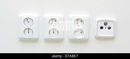 Closeup shot with white sockets and one radio TV socket. - Stock Photo