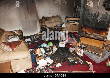 House Fire lounge burnt accidental dropped cigarette - Stock Photo