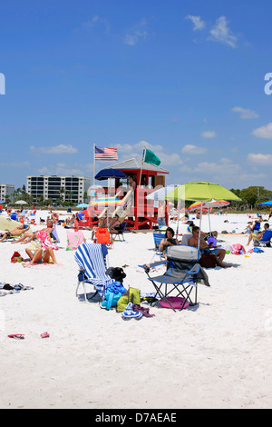Red Lifeguard tower on Siesta Key public beach in Florida - Stock Photo