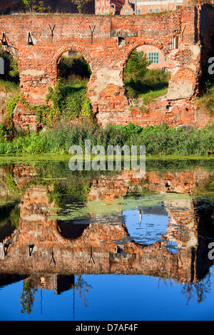 Ruins of an old building with reflections on Motlawa river waters, destroyed during World War II, city of Gdansk, - Stock Photo