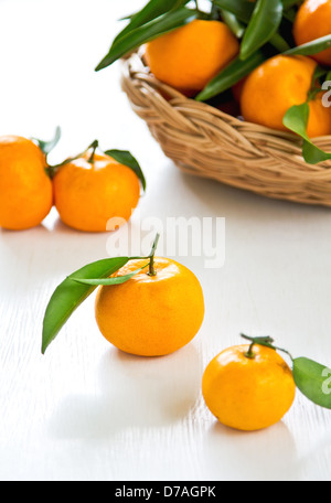 Fresh oranges in a bamboo basket - Stock Photo