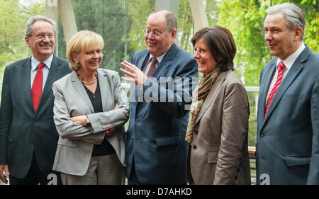 SPDchancellor candidate Peer Steinbrueck (C), Mayor of Munich ChristianUde (L), Governor of North Rhine-Westphalia - Stock Photo