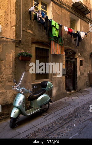 A moped in the streets of Cagliari in Sardinia - Stock Photo