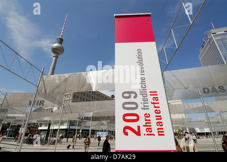 Exhibition on Alexanderplatz commemorating 20 years since the fall of the Berlin wall, Berlin Germany. - Stock Photo