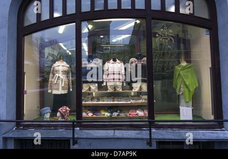 Shop window display showing traditional Estonian knitted clothing in Tallinn, Estonia - Stock Photo