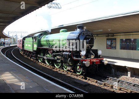 Preserved steam locomotive Mayflower 61306 passing through Carnforth station at the start of a loaded test run on - Stock Photo