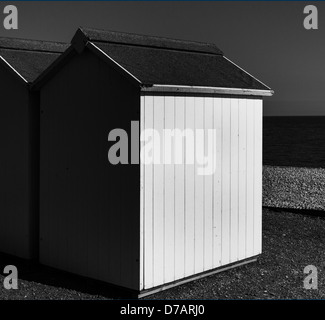 Beach huts on Budleigh Salterton beach in monochrome, Devon, England - Stock Photo
