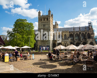 Exeter Cathedral Yard showing cathedral and cafes, Devon, England - Stock Photo