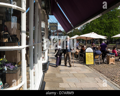 Exeter Cathedral Yard showing old shops and cafe, Devon, England - Stock Photo