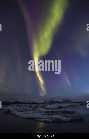 Aurora borealis dances over the glacial lagoon jokulsarlon; iceland - Stock Photo