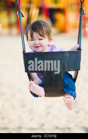 Happy 6 Month Old Baby Girl In A Swing By Park Ontario