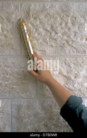 a hand on a Mezuza - Stock Photo