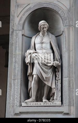 Statue of Niccola Pisano on Facade of Galleria degli Uffizi Art Museum, Florence, Italy - Stock Photo