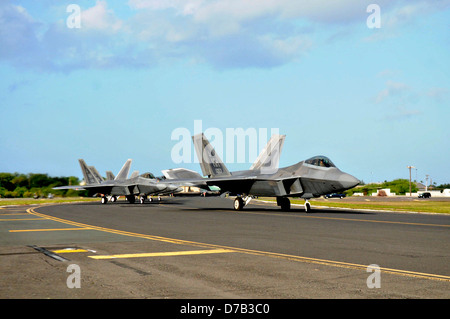 US Air Force F-22 Raptor stealth fighter aircraft taxi to takes off April 6, 2013 at Joint Base Pearl Harbor-Hickam, - Stock Photo