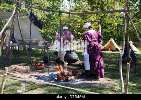 Women with a cooking pot over a campfire, live role-playing in front of the Musée d'Art Moderne Grand-Duc Jean, - Stock Photo
