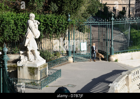 Pierre Puget Statue Public Garden or Park Entrance and Woman Walking Dog Marseille France - Stock Photo