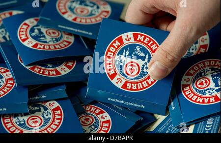 Condoms with a logo and the lettering 'My Hamburg Condom' are presented at a press conference of the German AIDS - Stock Photo
