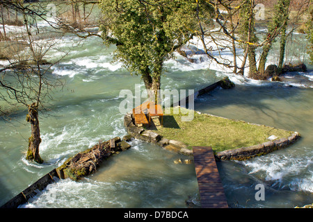 Resting place in pure nature on small river island in village Rastoke in Croatia - Stock Photo