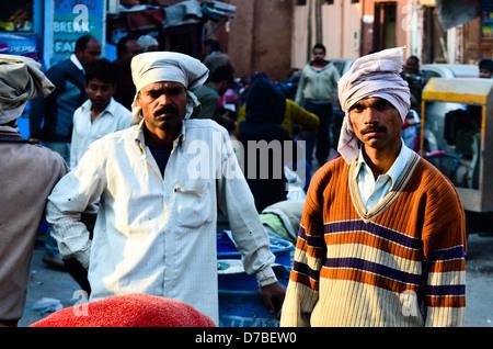 AGRA, INDIA – 23 JANUARY: Construction workers repair road near the Taj Mahal on 23 January 2013 in Agra. - Stock Photo
