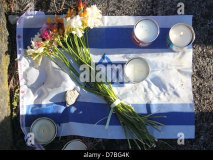 Israeli flag and memorial candles commemorating the Jewish holocaust victims at Treblinka extermination camp in - Stock Photo
