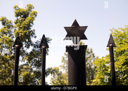 Star of David shapes decorate the fence of the Jewish cemetery in Kielce, Poland - Stock Photo