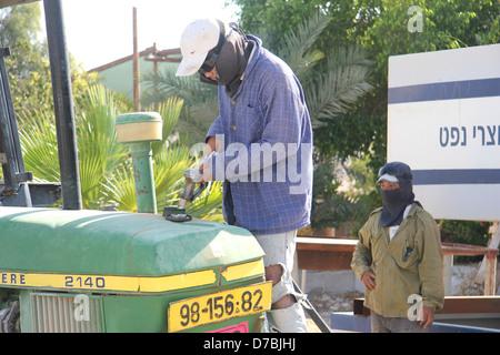 Refueling a John Deere tractor in Kibbutz Ketura in the Arava - Stock Photo
