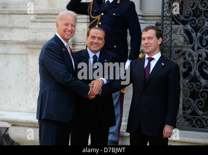 US Vice President Joe Biden meets Italian Prime Minister Silvio Berlusconi and Russian President Dmitry Medvedev - Stock Photo
