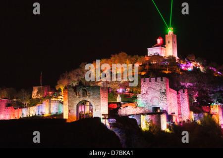 Floodlit Tsarevets fortress and laser light and sound show, Veliko Tarnovo, Bulgaria - Stock Photo