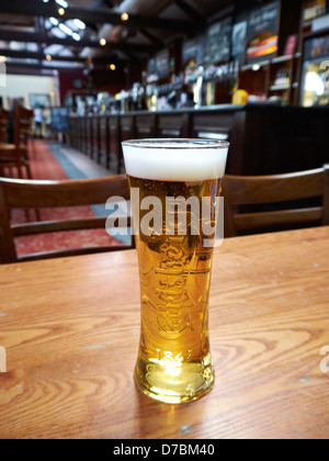 A pint of Carlsberg lager - Stock Photo